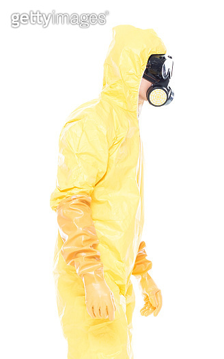 Man in protective clothing standing on white background