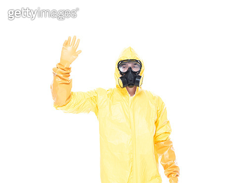 Man in protective clothing waving