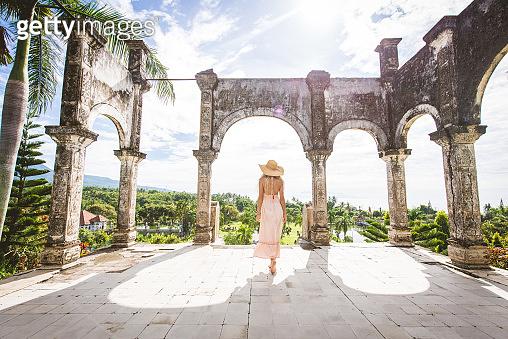 Beautiful girl at Water Palace in Bali