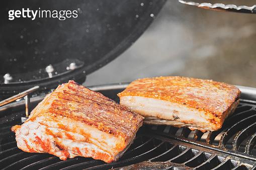 Crispy pork on grill