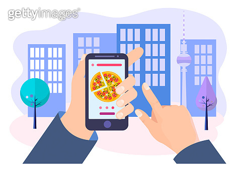The customer's hands holds the mobile phone with pizza on the screen on the city background