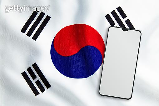 Modern Mobile Phone on Full Frame South Korean Flag