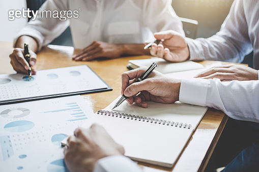 Co working conference, Business team meeting present discussing working analysis with financial data and marketing growth report graph in team, Finance, accounting, investment