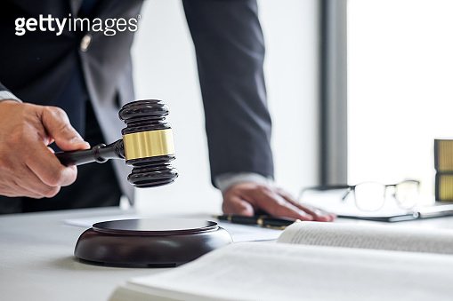 Judge gavel with Justice lawyers, Businessman in suit or lawyer working on a documents in courtroom. Legal law, advice and justice concept