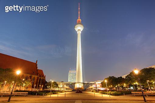 BERLIN, GERMANY, AUGUST 18, 2015: night view of fernsehturm with neptun fountain in berlin.