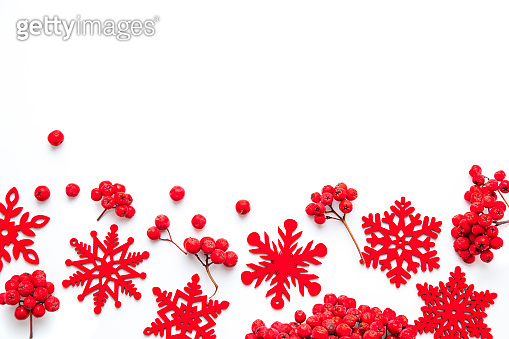 Winter composition. Frame made of snowflakes and red berries Rowan on white isolated background. Christmas, winter, new year concept. Flatlay, top view, copy space