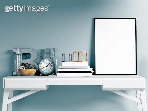 Mock up poster on working desk, blue background