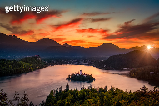 Colorful landscape sunrise at Lake Bled with dramatic sky, Slovenia