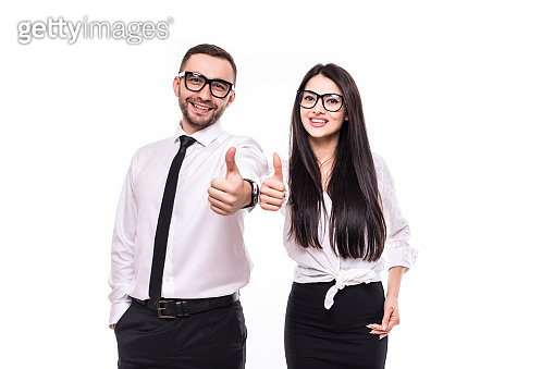 Two smiling happy businesspeople in formalwear showing thumbs-up on white background