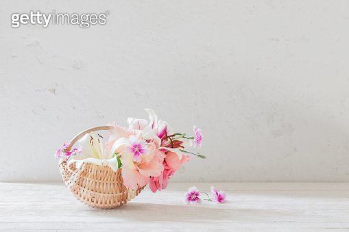 summer flowers in basket on white background