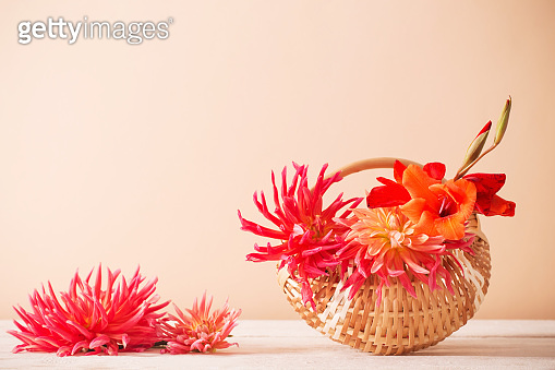 summer flowers in basket on wooden table
