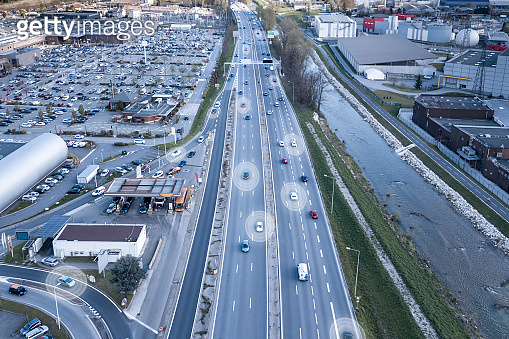 Autonomous vehicles on highway with self driving cars sensing environment by radar and operating safely on speedway thanks to artificial intelligence and control systems, automated transport concept