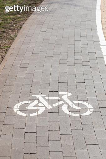 White bike path sign
