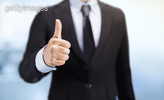 Business man shows thumb up sign gesture