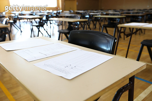 interior inside view of an exam hall set up in preparation for a major assessment test or examination.