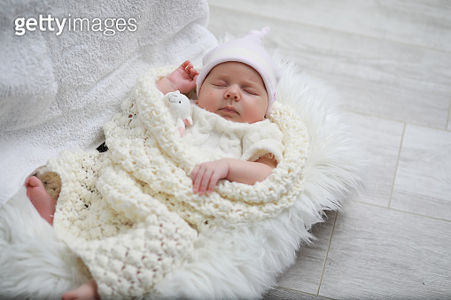 Baby newborn sleeping wrapped up in a blanket