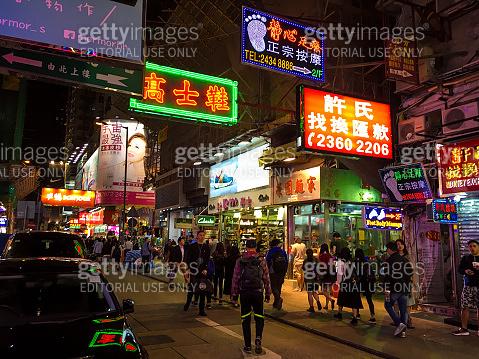 Hong Kong busy street traffic neon crosswalk crowd