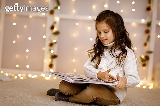 child girl is reading book