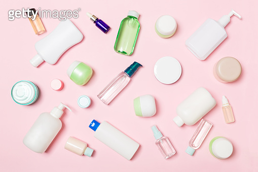 Group of plastic bodycare bottle Flat lay composition with cosmetic products on pink background empty space for you design. Set of White Cosmetic containers, top view with copy space
