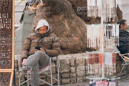 Bored souvenir seller in Ohrid