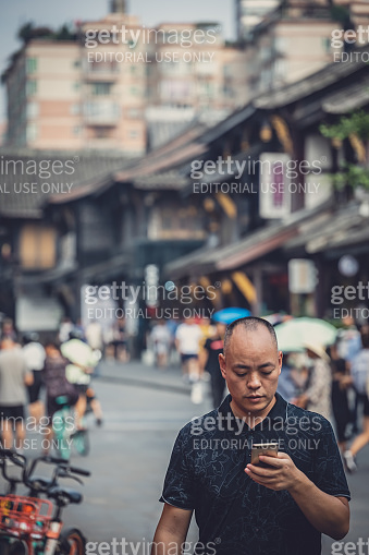 Man with a smartphone in the Chengdu city