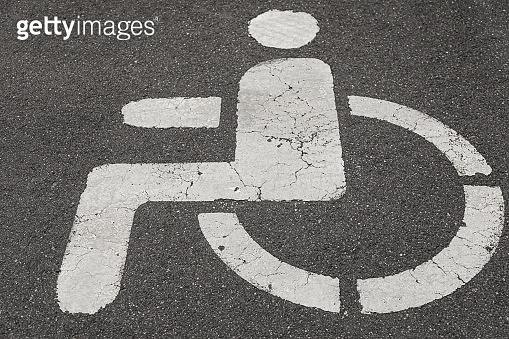 Close-up of road marking on asphalt: Parking spot for handicapped people