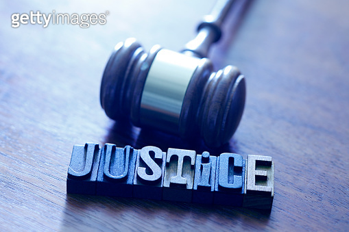 Gavel And Letters Spelling Out The Word Justice