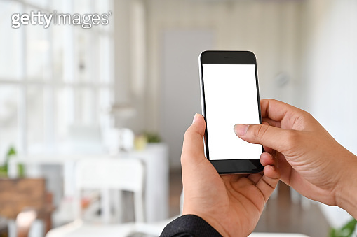 Cropped shot hands touch on mobile phone screen, clipping path display.