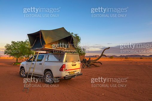 Tent located on the roof of a pickup 4x4 car in a desert camp, Namibia