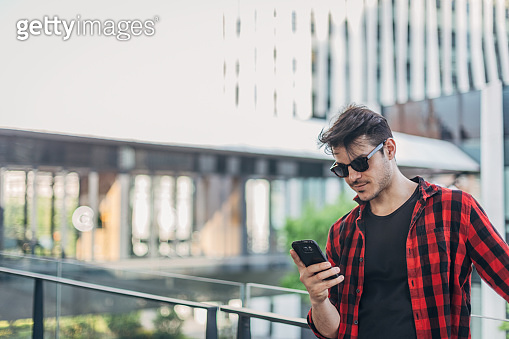 Handsome man using smart phone