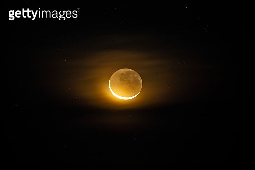 Waxing crescent moon as seeing from the southern hemisphere. Amazing the moon rough surface full of craters from meteorites coming from the universe and crashing our satellite the Moon an awe relief