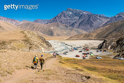 Trekking inside Andes valleys, central Chile at Cajon del Maipo, Santiago de Chile, amazing views over mountains, rivers and glaciers with an awesome hiking inside a rugged beautiful landscape