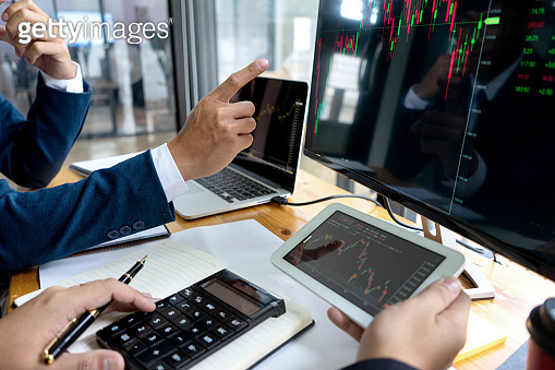 businessman sit at ther table looking at computer