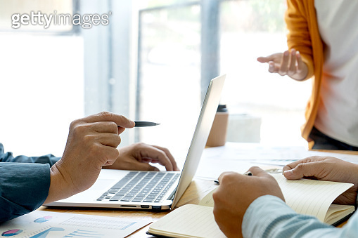 Young businessman creative meeting staff hand point to laptop,Young businessman creative