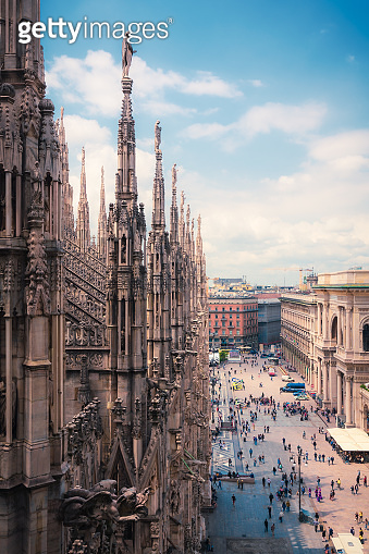 View of people enjoying Piazza del Duomo with the ornate archite