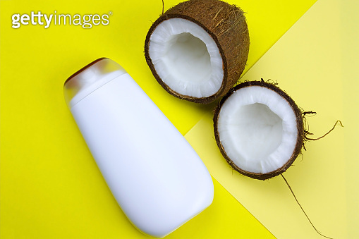 coconut and mock upwhite  plastic  bottle  on a yellow background