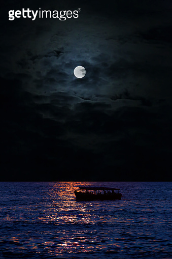 full moon over the sea, the silhouette of the ship