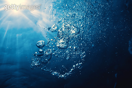 Underwater bubbles with sunlight. Underwater background bubbles.