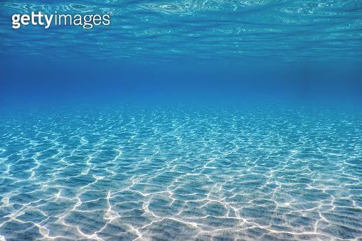 Underwater Blue Ocean, Sandy sea bottom Underwater background