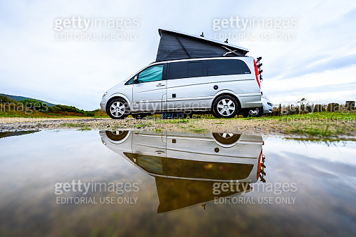 Afife beach, Portugal - October 30, 2018: Campervan or motorhome camping on rainy day with rain puddles.
