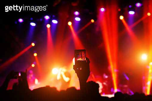 Shooting on mobile phone. Concert on stage.