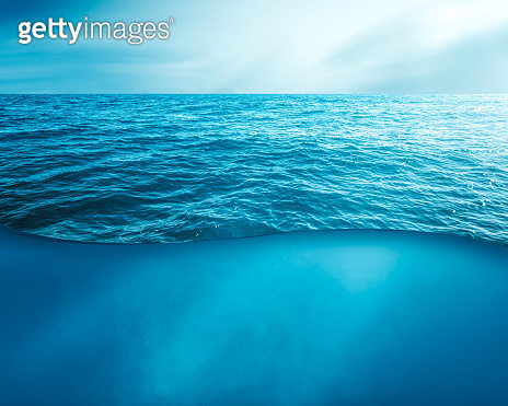 wavy sea water surface with sky and underwater