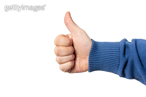 Male hand with thumbs up sign, isolated on white background.