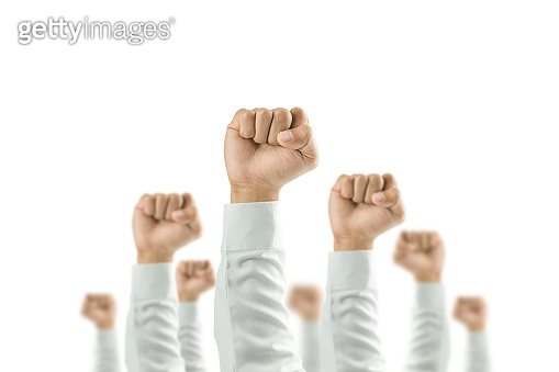 Businessmen raised their hands to win the celebration of the organization.The concept of business is geared towards success,sunlight effect.