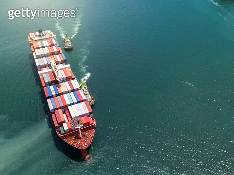 Aerial view Container cargo ship in the sea carrying to Terminal Port,Industry business logistic and transportation in Thailan