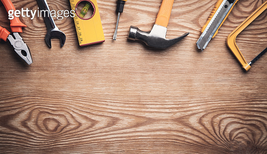 Work tools on wooden background.