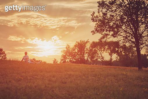 Man enjoying sunset/sunrise in nature.