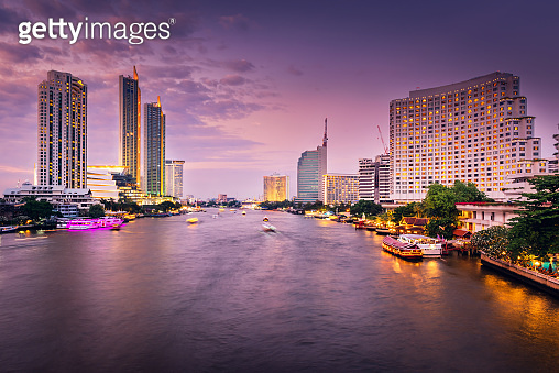 Business Downtown and Cityscape Riverside of Bangkok City at Twilight Sunset Scene, Travel Destination and Famous Place of Southeast Asia, Thailand. Business Traveling Chao Phraya River in Bangkok