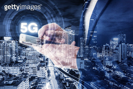Business Technology Telecommunication and Communication 5G Network Connection Concept, Double Exposure of Businesswoman Using Mobile Phone With Graphic Media Screen and Cityscape Skyscrapers
