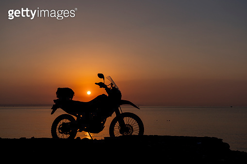 Motorcycle ride at sunrise